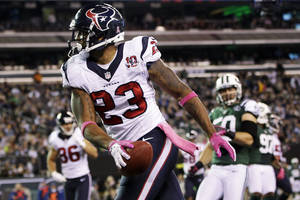 Photo -   Houston Texans running back Arian Foster (23) celebrates after rushing for a touchdown during the first half of an NFL football game against the New York Jets, Monday, Oct. 8, 2012, in East Rutherford, N.J. (AP Photo/Kathy Willens)