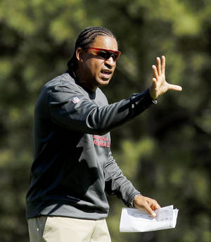 Photo -   FILE - This July 26, 2012 file photo shows Arizona Cardinals defensive coordinator Ray Horton working with his defense during at Northern Arizona University in Flagstaff, Ariz. In Horton's second season as Arizona's defensive coordinator, the Cardinals are 3-0 and there's no doubt he is a big reason why. (AP Photo/Ross D. Franklin, File)