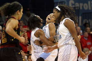 photo - North Carolina's Latifah Coleman, second from right, celebrates her 3-pointer with Danielle Butts, second from left, and Tierra Ruffin-Pratt, right, near Maryland's Chloe Pavlech, left, during the second half of an NCAA college basketball game in Chapel Hill, N.C., Thursday, Jan. 3, 2013. North Carolina won 60-57. (AP Photo/Ted Richardson)