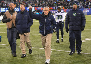 Photo - Seattle Seahawks head coach Pete Carroll gestures while leaving the field after an NFL football game against the New York Giants, Sunday, Dec. 15, 2013, in East Rutherford, N.J. The Seahawks won 23-0. (AP Photo/Bill Kostroun)