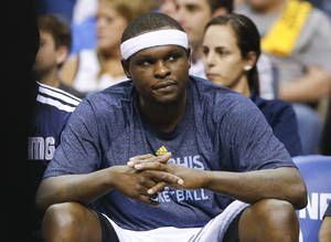 Photo - Memphis Grizzlies forward Zach Randolph sits on the bench in the second half of Game 6 of an opening-round NBA basketball playoff series against the Oklahoma City Thunder, Thursday, May 1, 2014, in Memphis, Tenn. Oklahoma City won 104-84 to even the series 3-3. (AP Photo/Mark Humphrey)