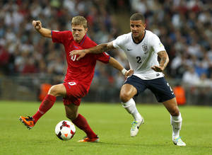 Photo - England's Kyle Walker, right, vies for the ball with Moldova's Alexandru Dedov during the World Cup group H qualifier soccer match between England and Moldova at Wembley Stadium in London, Friday, Sept. 6, 2013. (AP Photo/Sang Tan)