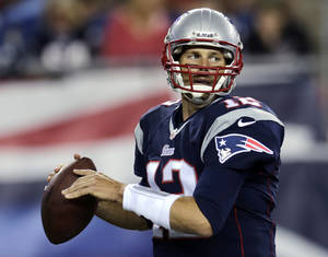 Photo - New England Patriots quarterback Tom Brady looks to pass against the Tampa Bay Buccaneers during the first quarter of an NFL preseason football game Friday, Aug. 16, 2013, in Foxborough, Mass. (AP Photo/Charles Krupa)