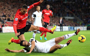 Photo - Swansea City's Andrew Taylor (right) and Cardiff City's Peter Odemwingie battle for the ball during the English Premier League match at the Cardiff City Stadium, Sunday Nov. 3, 2013. (AP Photo / Nick Potts/PA) UNITED KINGDOM OUT  NO SALES  NO ARCHIVE