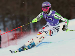 Photo - Germany's Maria Hoefl-Riesch speeds down the course on her way to take third place in a women's alpine ski World Cup super-combined event, in Altenmarkt-Zauchensee, Austria, Sunday, Jan. 12 , 2013. (AP Photo/Enrico Schiavi)