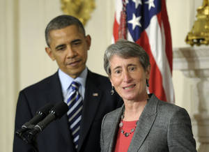 Photo - President Barack Obama listens as his Interior Secretary nominee, REI Chief Executive Officer Sally Jewell speaks in the State Dining Room of the White House in Washington, Wednesday, Feb. 6, 2013. (AP Photo/Susan Walsh)