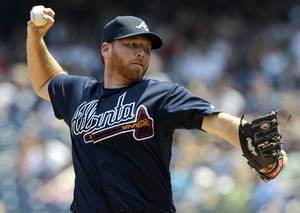 photo - FILE - In this June 20, 2012, file photo, Atlanta Braves starting pitcher Tommy Hanson delivers in the second inning of a baseball game against the New York Yankees at Yankee Stadium in New York. The Braves traded Hanson to the Los Angeles Angels for former closer Jordan Walden on Friday, Nov. 30, 2012. (AP Photo/Kathy Willens, File)