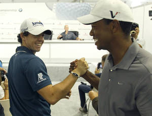 Photo -   Rory McIlroy of Northern Ireland, left, shakes with Tiger Woods between interviews during the Pro-Am of the BMW Championship PGA golf tournament at Crooked Stick Golf Club in Carmel, Ind., Wednesday, Sept. 5, 2012. (AP Photo/Charles Rex Arbogast)