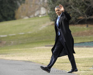photo - President Barack Obama waves as he walks to Marine One on the South Lawn of the White House in Washington, Monday, Feb. 4, 2013. Obama will pitch his gun control proposals to the public and the law enforcement community in Minneapolis Monday, as he calls for a ban on assault weapons and seeks to install universal background checks for gun buyers.  (AP Photo/Susan Walsh)