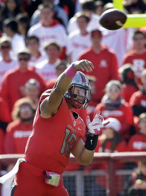 Photo - Rutgers quarterback Gary Nova (10) throws a pass during the first half of an NCAA college football game against Houston in Piscataway, N.J., Saturday, Oct. 26, 2013. Houston won 49-14. (AP Photo/Mel Evans)