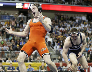 Photo - OSU's Chris Perry reacts after defeating Penn State's Matt Brown in the 174-pound title match last season. Perry is currently ranked No. 2 at 174 pounds this seasonAP Photo