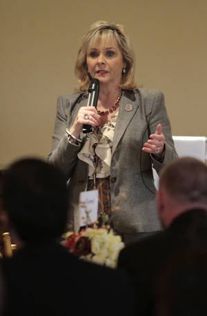 Photo - Gov. Mary Fallin speaks at the Edmond Area Chamber of Commerce luncheon.