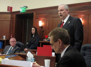 Photo - RETRANSMITTING TO REMOVE REFERENCE TO CATHY GIESSEL, WHO IS NOT IN THE PHOTO Sen. Bert Stedman, R-Sitka, top right, speaks on the floor of the Alaska Senate during discussion of proposed amendments to a bill aimed at advancing a major liquefied natural gas project on Tuesday, March 18, 2014, in Juneau, Alaska. Shown in the row in front of him is Sen. Dennis Egan. Seated beside him is Sen. Kevin Meyer. (AP Photo/Becky Bohrer)