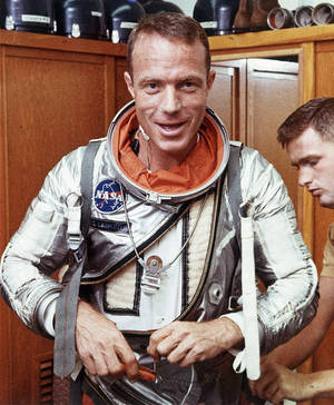 Photo - FILE - In this Aug. 1962 file photo, astronaut Scott Carpenter has his space suit adjusted by a technician in Cape Canaveral, Fla. Carpenter, the second American to orbit the Earth and one of the last surviving original Mercury 7 astronauts, died Thursday, Oct. 10, 2013. He was 88. (AP Photo, File)