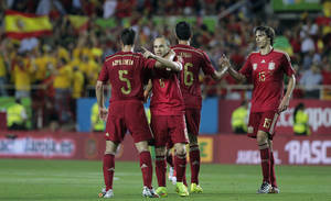 Photo - Spain's Andres iniesta, second left, celebrates with teammate Cesar Azpilicueta, left, after scoring against Bolivia during their friendly soccer match in Seville, Spain on Friday, May 30. 2014. (AP Photo/Miguel Angel Morenatti)