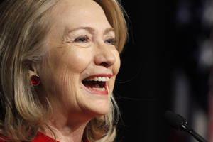 photo - Former Secretary of State Hillary Rodham Clinton laughs as she gives a speech during a ceremony honoring her at the Pentagon, Thursday, Feb. 14, 2013, where outgoing Defense Secretary Leon Panetta presented her with the Defense Department's Medal for Distinguished Public Service. (AP Photo/Jacquelyn Martin)
