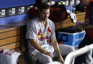 Photo - St. Louis Cardinals starting pitcher Adam Wainwright sits in the dugout after the eighth inning of a baseball game, in which he gave up a run on an RBI single by Los Angeles Dodgers' Justin Turner to score Juan Uribe, Thursday, June 26, 2014, in Los Angeles. The Dodgers won 1-0. (AP Photo/Danny Moloshok)