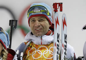 Photo - Norway's Ole Einar Bjoerndalen smiles after winning the gold during the mixed biathlon relay at the 2014 Winter Olympics, Wednesday, Feb. 19, 2014, in Krasnaya Polyana, Russia. (AP Photo/Lee Jin-man)