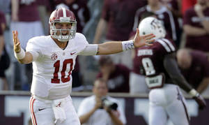 Photo - Alabama quarterback AJ McCarron (10) celebrates after throwing a touchdown pass to Jalston Fowler during the fourth quarter of an NCAA college football game against Texas A&M Saturday, Sept. 14, 2013, in College Station, Texas. Alabama won 49-42. (AP Photo/David J. Phillip)