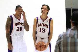 Photo - Phoenix Suns' Steve Nash (13) and new teammate Shannon Brown (26) pose for photos during an NBA basketball media day on Friday, Dec. 16, 2011, in Phoenix. (AP Photo/Ross D. Franklin)