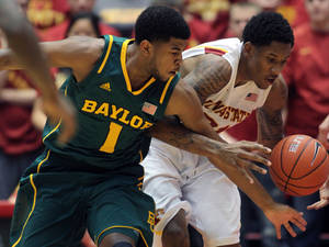 Photo - Baylor guard L.J. Rose (1) and Iowa State guard Will Clyburn (21) fight for control of a loose ball in the first half of an NCAA college basketball game Saturday, Feb. 2, 2013, at Hilton Coliseum in Ames, Iowa. (AP Photo/Justin Hayworth)