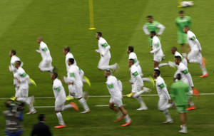 Photo - Algeria national soccer team players warm up during an official training session the day before the group H World Cup soccer match between South Korea and Algeria at the Estadio Beira-Rio in Porto Alegre, Brazil, Saturday, June 21, 2014.  (AP Photo/Lee Jin-man)