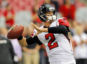Photo - Atlanta Falcons quarterback Matt Ryan warms up prior to an NFL football game against the Arizona Cardinals, Sunday, Oct. 27, 2013, in Glendale, Ariz. (AP Photo/Matt York)