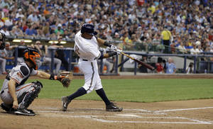 Photo - Milwaukee Brewers' Khris Davis hits a home run during the sixth inning of a baseball game against the Baltimore Orioles Monday, May 26, 2014, in Milwaukee. (AP Photo/Morry Gash)