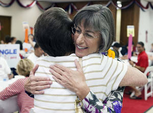 Photo -   Democratic U.S. Senate candidate Linda Lingle hugs a supporter at her campaign headquarters, Tuesday, Nov. 6, 2012 in Honolulu. (AP Photo/Marco Garcia)