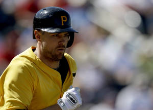 Photo - Pittsburgh Pirates' Jordy Mercer runs to first base after hitting a single in the eighth inning of a spring training exhibition baseball game against the Minnesota Twins, Sunday, March 10, 2013, in Fort Myers, Fla. Pittsburgh won 7-4. (AP Photo/David Goldman)