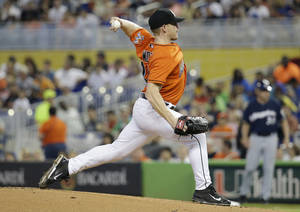 Photo - Miami Marlins starting pitcher Randy Wolf throws in the first inning during a baseball game against the Milwaukee Brewers, Sunday, May 25, 2014, in Miami. (AP Photo/Lynne Sladky)