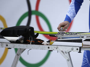 Photo - A service technician waxes a ski prior to the cross-country sprint competitions at the 2014 Winter Olympics, Tuesday, Feb. 11, 2014, in Krasnaya Polyana, Russia. (AP Photo/Gregorio Borgia)