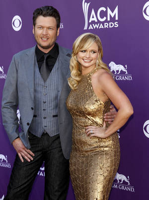 Photo - Blake Shelton, left, and Miranda Lambert arrive at the 47th Annual Academy of Country Music Awards on April 1, 2012, in Las Vegas. AP Photo
