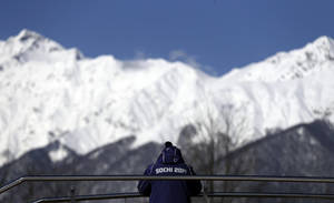Photo - A member of the security team watches over the sliding center during women's luge training at the 2014 Winter Olympics, Tuesday, Feb. 4, 2014, in Krasnaya Polyana, Russia. (AP Photo/Natacha Pisarenko)