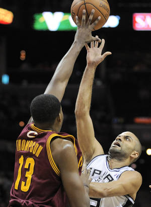 Photo -   San Antonio Spurs' Tony Parker, right, of France, shoots over Cleveland Cavaliers' Tristan Thompson during the first half of an NBA basketball game, Sunday, April 22, 2012, in San Antonio. (AP Photo/Darren Abate)