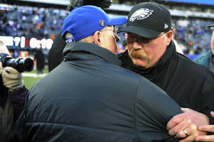 Photo - Philadelphia Eagles head coach Andy Reid, right, shakes hands with New York Giants head coach Tom Coughlin after an NFL football game, Sunday, Dec. 30, 2012, in East Rutherford, N.J. The Giants won 42-7. (AP Photo/Bill Kostroun)