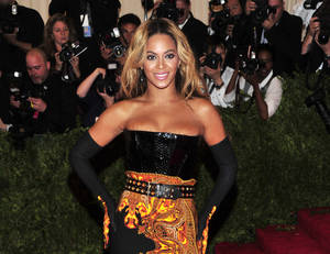 "Photo - FILE - This May 6, 2013 file photo shows singer Beyonce at The Metropolitan Museum of Art's Costume Institute benefit in New York.  Beyonce has released her new album in an unconventional way: She announced and dropped it on the same day. The singer released ""Beyonce"" exclusively on iTunes early Friday, Dec. 13.  (Photo by Charles Sykes/Invision/AP, File)"