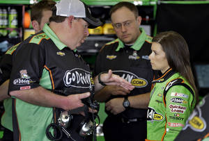 photo - Daytona 500 pole sitter Danica Patrick, right, talks to crew chief Tony Gibson during a practice for the Daytona 500 NASCAR Sprint Cup Series auto race Friday, Feb. 22, 2013, at the Daytona International Speedway in Daytona Beach, Fla. (AP Photo/Chris O'Meara)