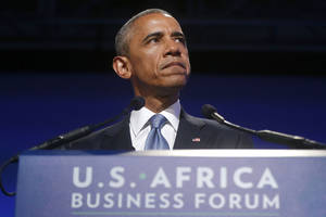 Photo - President Barack Obama pauses as he speaks at the US Africa Business Forum during the US Africa Leaders Summit, Tuesday, Aug. 5, 2014, at the Mandarin Oriental Hotel in Washington. African heads of state are gathering in Washington for an unprecedented summit to promote business development. (AP Photo/Charles Dharapak)