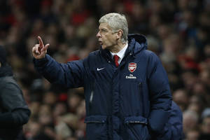 Photo - Arsenal's manager Arsene Wenger gestures as he watches his team play against Crystal Palace during their English Premier League soccer match at Emirates Stadium in London, Sunday, Feb. 2, 2014. (AP Photo/Sang Tan)