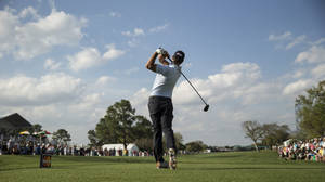 Photo - Adam Scott tees off on the 18th hole during the second round of the Arnold Palmer Invitational golf tournament at Bay Hill Friday, March 21, 2014, in Orlando, Fla. (AP Photo/ Willie J. Allen Jr.)