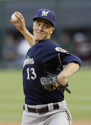 Photo -   Milwaukee Brewers starting pitcher Zack Greinke delivers during the first inning of an interleague baseball game against the Chicago White Sox, Friday, June 22, 2012, in Chicago. (AP Photo/Charles Rex Arbogast)
