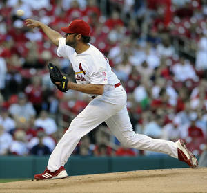 Photo -   St. Louis Cardinals' starting pitcher Jake Westbrook throws against the Milwaukee Brewers in the first inning in a baseball game on Saturday, Sept. 8, 2012, at Busch Stadium in St. Louis. (AP Photo/Bill Boyce)
