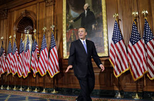 photo - In this Jan. 3, 2013, photo, House Speaker John Boehner of Ohio, leaves after a three hour photo session with members of the new 113th Congress that convened earlier in the day. The Republican Party seems as divided and angry as ever. Infighting has penetrated the highest levels of the House GOP leadership. Long-standing geographic tensions have increased, pitting endangered Northeastern Republicans against their colleagues from other parts of the country. Enraged tea party leaders are threatening to knock off dozens of Republicans who supported a measure that raised taxes on the nation's highest earners. (AP Photo/J. Scott Applewhite)