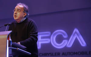 Photo - Chrysler Group LLC Chairman and CEO Sergio Marchionne speaks to investors at the automaker's world headquarters in Auburn Hills, Mich., Tuesday, May 6, 2014. Fiat Chrysler Automobiles NV unveiled its business strategy for the next five years as it prepares for life as a newly merged company. (AP Photo/Carlos Osorio)