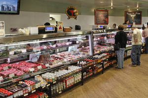 photo - The Meat House in Edmond sells local beef, produce and baked goods.  Photo by DAVID MCDANIEL, THE OKLAHOMAN archives
