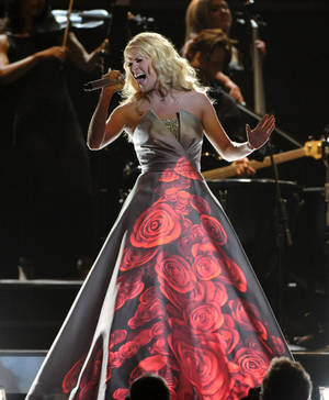 Photo - Carrie Underwood performs on stage at the 55th annual Grammy Awards on Sunday, Feb. 10, 2013, in Los Angeles. (Photo by John Shearer/Invision/AP) ORG XMIT: CAAR221