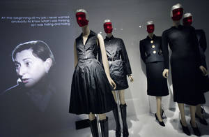 """Photo -   Miuccia Prada, left, speaks in a video about her two fashions, center, and those of Elsa Schiaparelli, right, at an exhibit at the Metropolitan Museum of Art, Monday, May 7, 2012 in New York. The show """"Schiaparelli and Prada, Impossible Conversations,"""" opens May 10 and continues through Aug. 19. (AP Photo/Mark Lennihan)"""