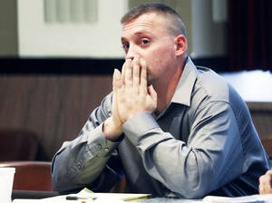 Photo - Christopher Dunham listens  at his trial Wednesday in Oklahoma City. He is charged with child neglect.AP Photo