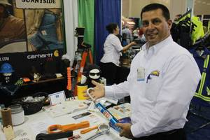 photo - Paul Battista, business development manager for Sunnyside Supply Inc., discusses some of the natural gas equipment his company manufactures and sells.  Photos by Adam Wilmoth, The Oklahoman